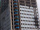 金地大厦人民路上的精装办公楼 外立面作业中