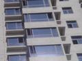 皓月大厦即将交房 窗户安装即将完成